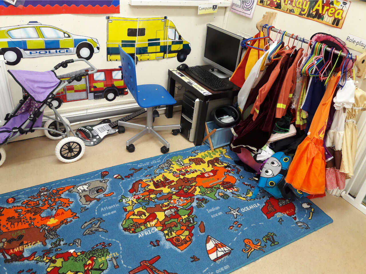 Role play area full of clothes from all over the world