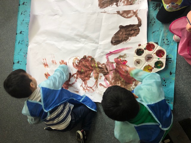 Young children being creative with paint